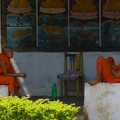 Two monks resting and chattering