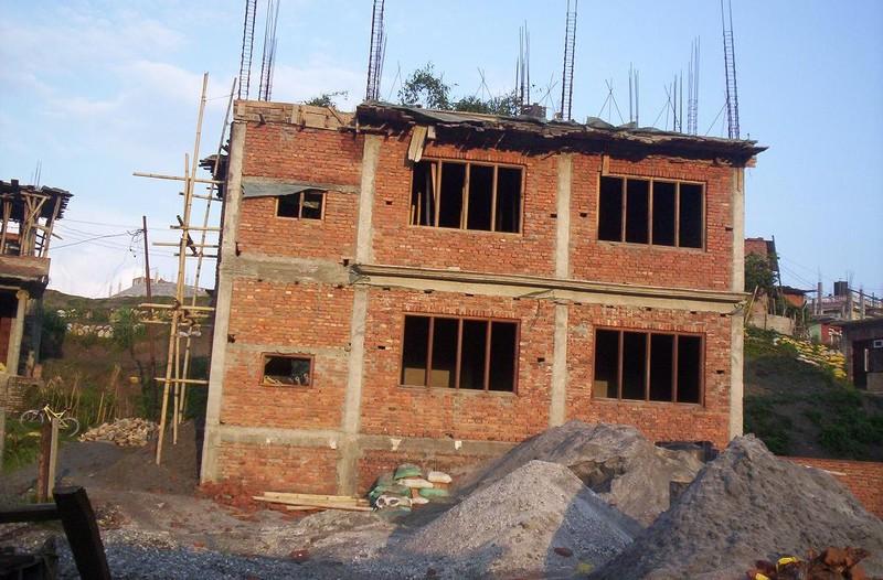Construction maison familiale de l 39 arri re photo de for Album photo construction maison