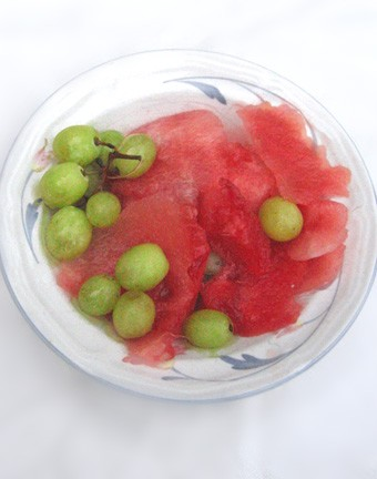 Sliced watermelon and grapes