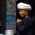 An old woman in Menghun food market